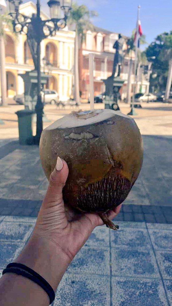 Fathom travel, fresh coconut from street vendor in Puerto Plata, Dominican Republic