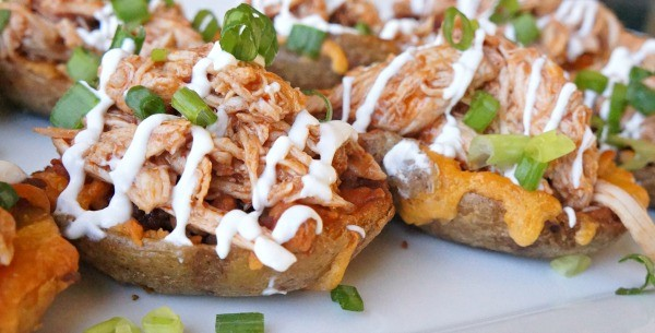 Loaded BBQ Chicken potato skins recipe, topped with sour cream and chives