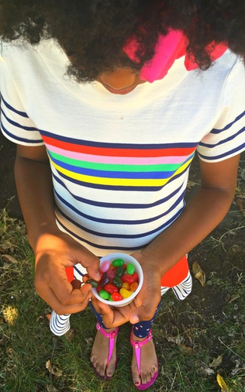 Girl with jelly beans in Mini Boden back to school clothes