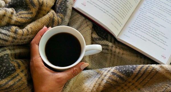 snuggle-up-on-the-couch-this-fall-with-a-book-and-a-warm-cup-of-coffee