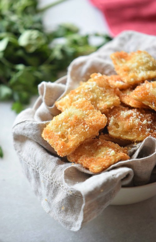 Oven toasted ravioli appetizer recipe with a Parmesan crust