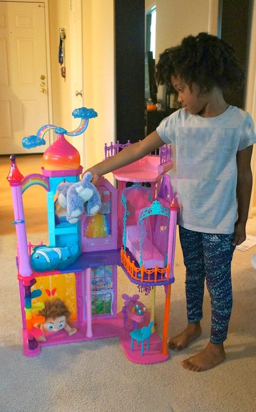 girl-plays-with-barbie-rainbow-cove-princess-castle-playset