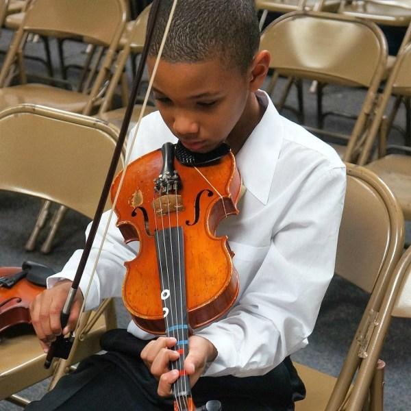 Kid playing the viola