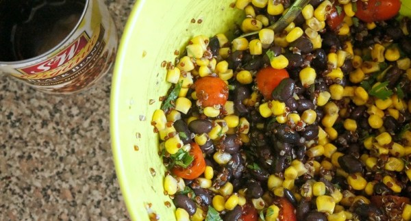 Making southwestern black bean and corn salad with quinoa, combine ingredients