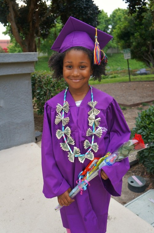 Pretty little girl on her graduation day - Honey and Lime