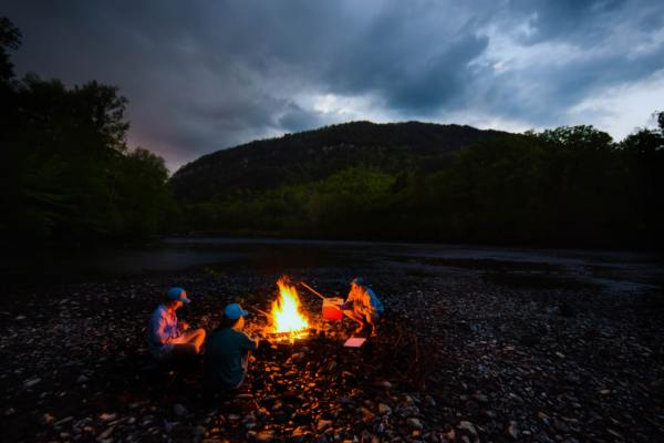Camping outdoors camp fire at dusk