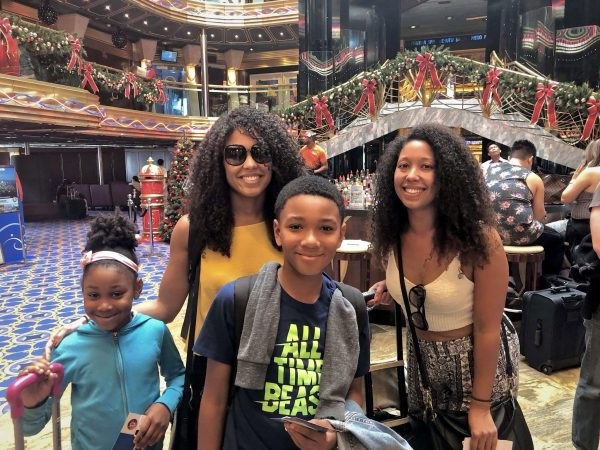 Family in the main atrium onboard the Carnival Imagination cruise ship
