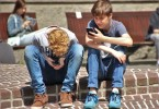 Teen tween kids using smartphones