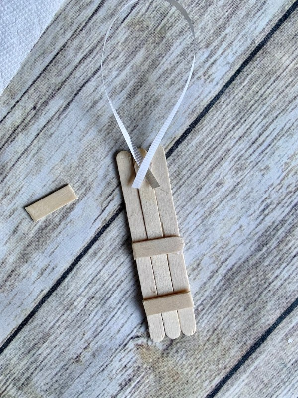 Glue popsicle sticks together