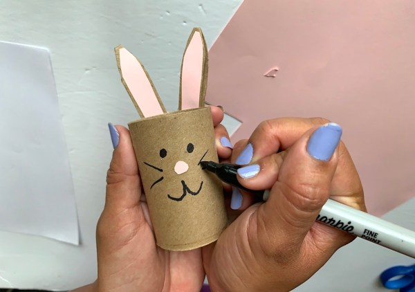 Draw the bunny face on the egg holder