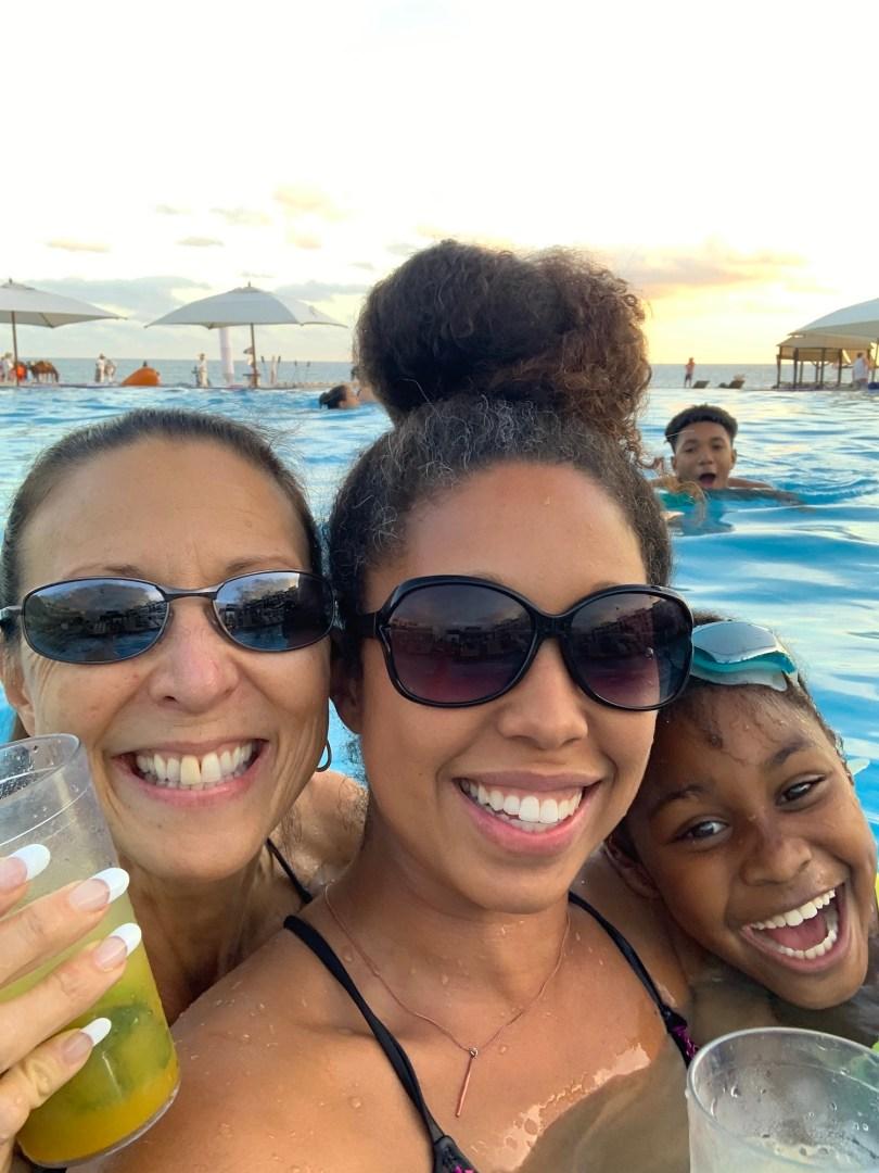Family in the infinity swimming pool at Hyatt Ziva