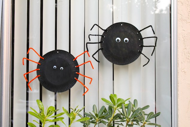 Paper plate spider craft hanging in the window