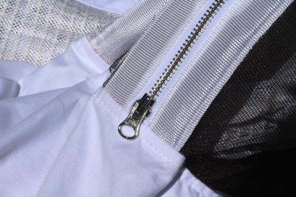 Extra-wide binding around the zipper
