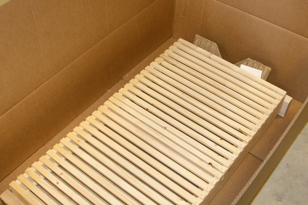 A slatted rack getting ready for shipment.