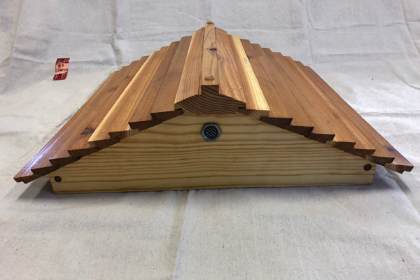 A vented gabled roof.