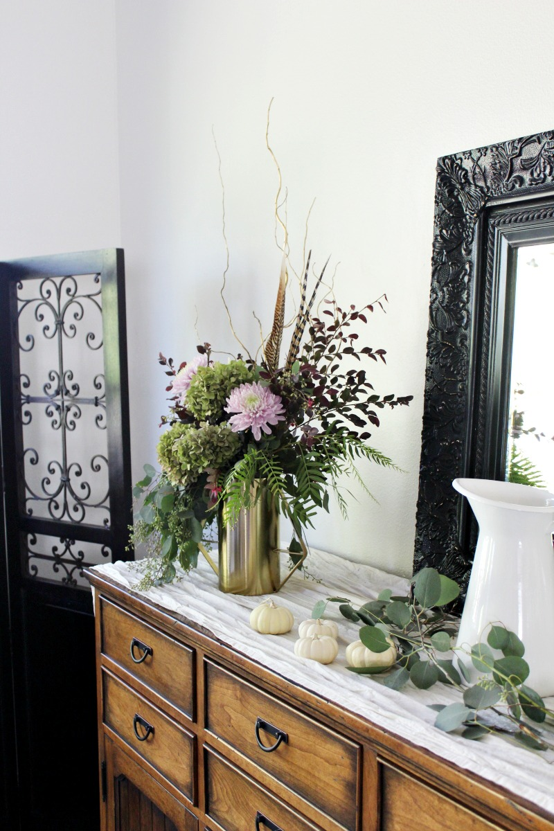 asymmetrical fall florals wtih pheasant feathers