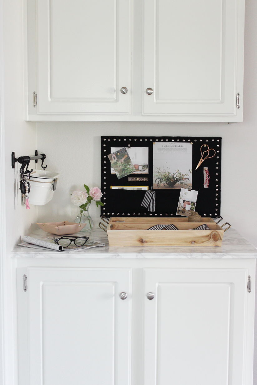 Command center made with IKEA products and a DIY black linen covered memo board