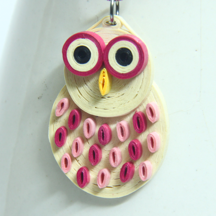 pink snowy owl made with paper quilling - Honey's Quilling