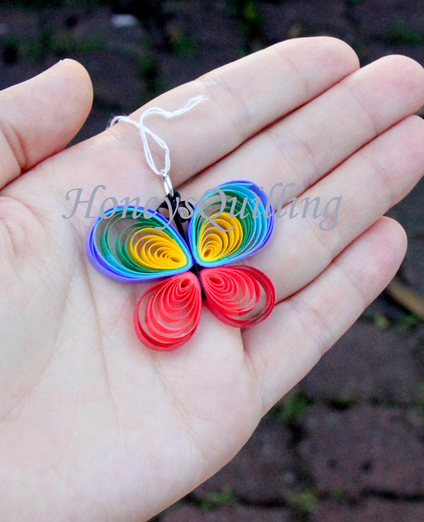 Make a paper quilled rainbow butterfly - free tutorial from Honey's Quilling