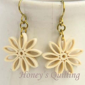 nine pointed star earrings - cream