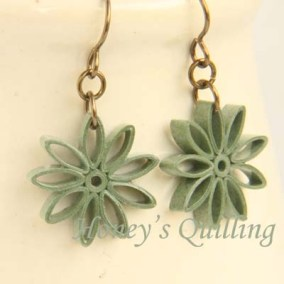 nine pointed star earrings - sage green