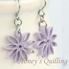 nine pointed star earrings - lavender