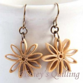 nine pointed star earrings - tan