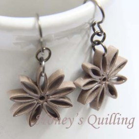 nine pointed star earrings - taupe