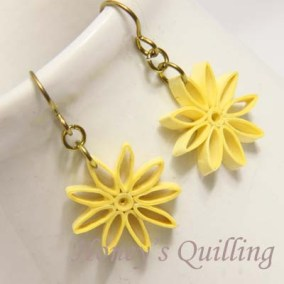 nine pointed star earrings - yellow