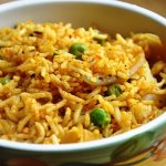 Aloo Tamatar Pulao (A Potato Rice Pilaf dish cooked with leftover Gravy)