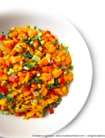 Recipe for Spicy Mango Salsa taken from www.hookedonheat.com. Visit site for detailed recipe.
