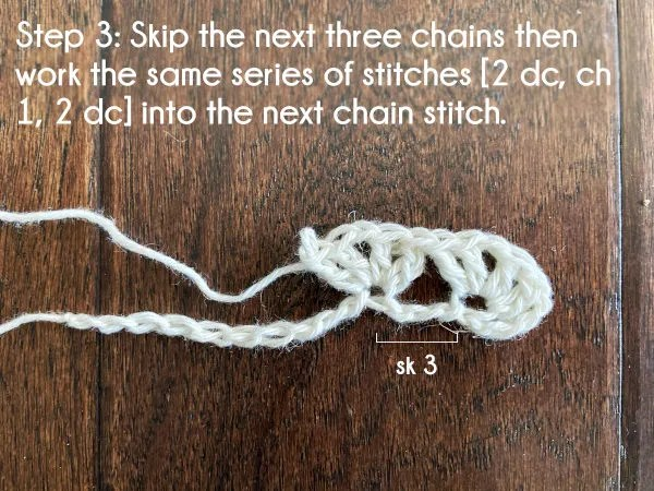 Text: Step 3: Skip the next three chains then work the same series of stitches [2 dc, ch 1, 2 dc] into the next chain stitch.