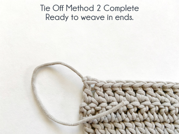 """Image shows swatch tied off with a tightened chain stitch and ready to weave in ends. Text reads: """"Tie Off Method 2 Complete: Ready to weave in ends."""""""