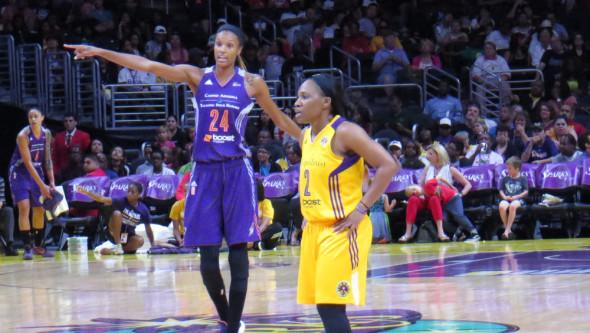 Phoenix's DeWanna Bonner and Los Angeles guard Temeka Johnson.