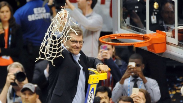 Connecticut head coach Geno Auriemma cuts the nets after his NCAA record-breaking (men's and women's) 11th national basketball title. Photo © Lee Michaelson, all rights reserved.