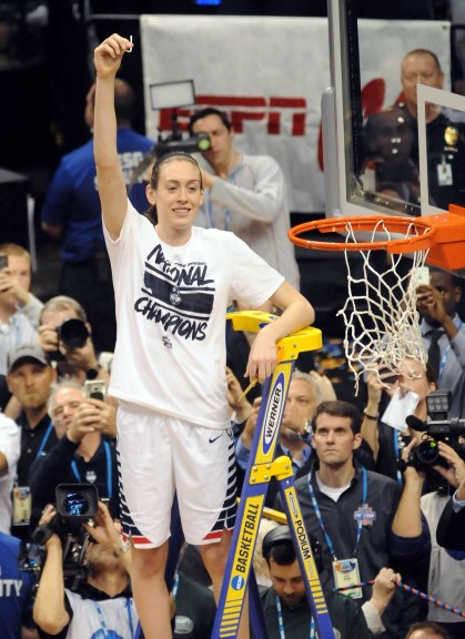 Connecticut sensation Breanna Stewart cuts the net after leading the Huskies to their fourth consecutive women's basketball national title. Stewart also took home Most Outstanding Player honors for the the fourth year in a row -- an NCAA first. Photo © Lee Michaelson.
