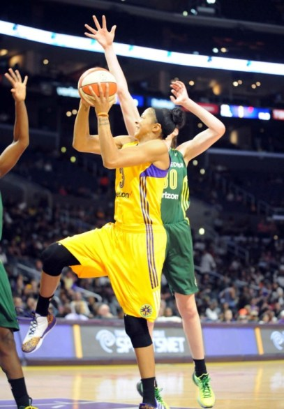 Candace Parker (Yellow, No. 3) threads the needle between Breanna Stewart (Green, No. 30) and a second Seattle defender. Parker led all scorers with 34 points, despite sitting out much of the final period. She also grabbed five rebounds, passed out four assists and grabbed three steals. Photo © Lee Michaelson, all rights reserved.