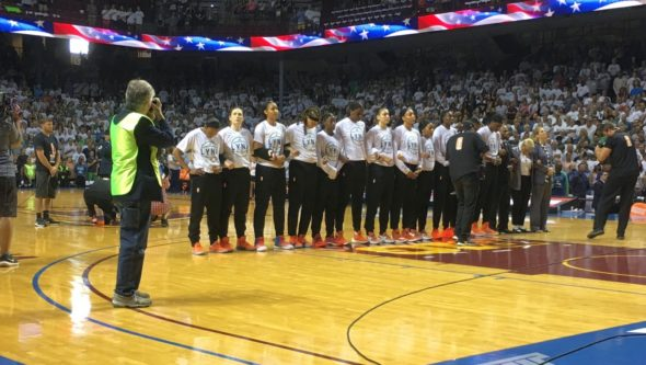 September 24, 2017 (Minneapolis) - Minnesota Lynx players stand with linked arms during national anthem before game one of the WNBA Finals. Los Angeles Sparks players decided to stay in the locker room during the anthem. Photo: © Lee Michaelson.