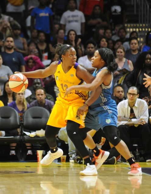 Chelsea Gray of the Los Angeles Sparks dribbles past Jia Perkins of the Minnesota Lynx. Photo © Lee Michealson.