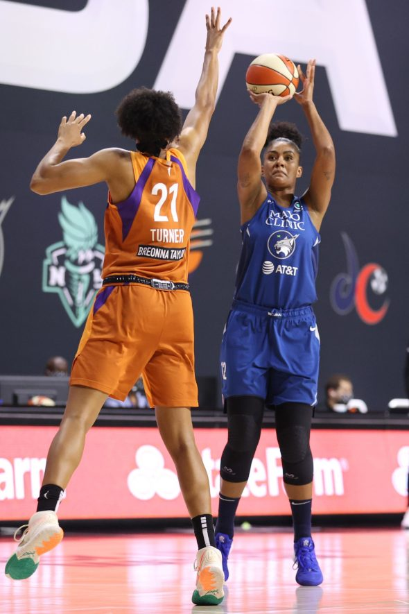 Damiris Dantas #12 of the Minnesota Lynx shoots the ball against the Phoenix Mercury during the WNBA playoffs on September 17, 2020 at Feld Entertainment Center in Palmetto, Florida. Photo: Stephen Gosling/NBAE via Getty Images.