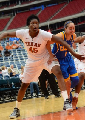 December 8, 2012 (Houston, Texas) – UCLA vs. Texas, Reliant Arena. Texas player Cokie Reed boxes out UCLA's Thea Lemberger. Photo © Robert Franklin, all rights reserved.