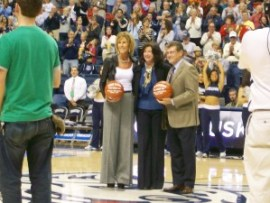 Chris Daily and Geno Auriemma honored before the game.