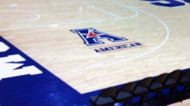 The American logo on the floor of SMU's Moody Coliseum.