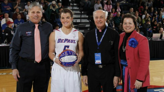 Anna Martin honored for reaching the 1,000 career-point mark before the DePaul's game vs. Marquette on February 12. Photo: DePaul Athletics.