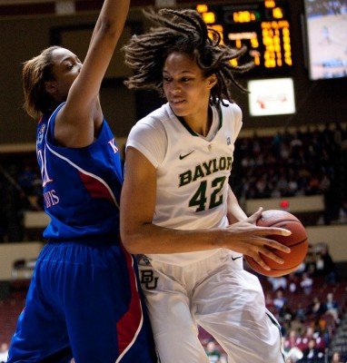 Kansas forward Carolyn Davis defends Baylor center Brittney Griner during last season's Big 12 tournament. The Lady Bears won 88-51.