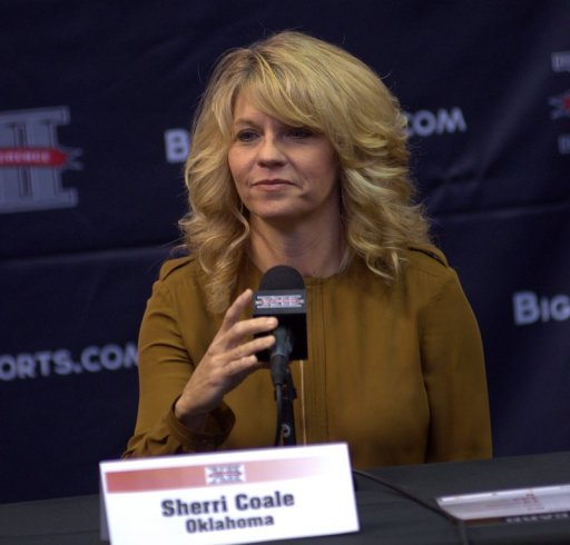 Oklahoma coach Sherri Coale at Big 12 Media Day listens to a question about lowering the rims in women's basketball. Photo: Robert Franklin, all rights reserved.