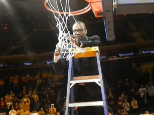 MInnesota assistant coach Kimani Young, a New York native, cuts down the net after the Golden Gophers won the NIT (Ray Floriani photo)