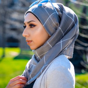 Hooriyah Collection's Plaid-French Bistre premium cotton viscose light hijab wrp,it has raw or frayed edges at wide boarders and has trxture engraed checkers or windowpane or grid