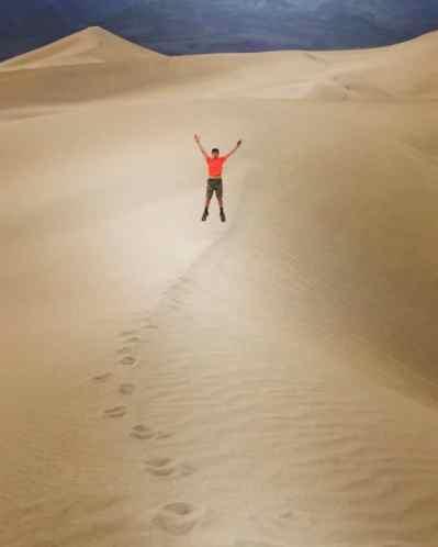 Aidan jumping on dunes
