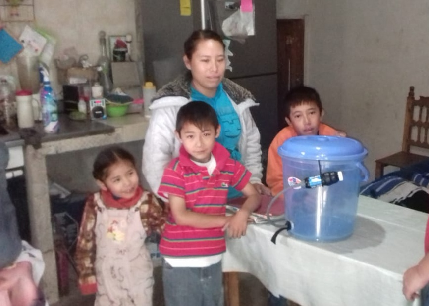 (July) Puebla, Mexico-- Pastor Sebastián Hernández Esteban from Iglesia Biblica Labranza de Dios partnered with HOPE Coffee to distribute clean water filters to the Solis family (pictured in previous picture) and the Hernandez family.  Before now, neither of these families had access to clean water! Their interest in the gospel message has deepened greatly as they strengthen their relationship with the people of the local church!